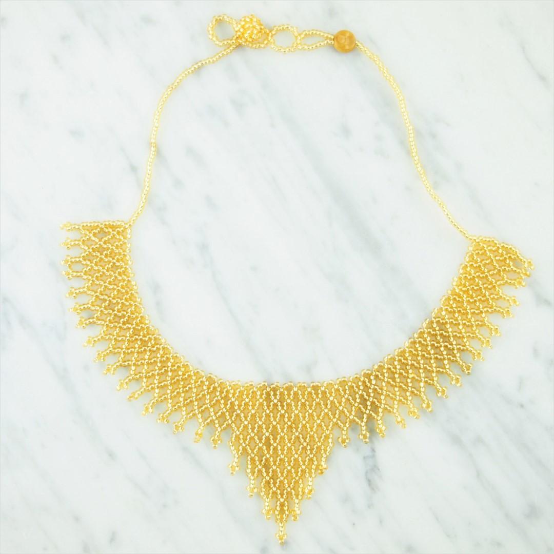 collier perles okamita fait main dor brillante chic authentique et thique. Black Bedroom Furniture Sets. Home Design Ideas